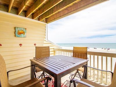 Photo for Family friendly oceanfront condo with amazing amenities, pool and beach access, outdoor gazebos and recreation center with gym indoor pool/jacuzzi and lounge areas.