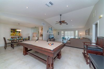 Hang out, play pool, grab a bite to eat or watch TV; this main living area is an awesome gathering place for families coming together on Marco.