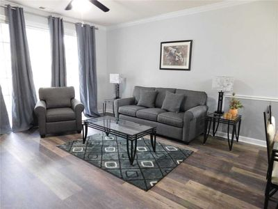 All New Floors and Freshly Painted 1st Floor Condo in River Crossing! You will love this property!