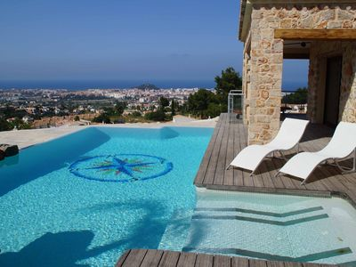 Photo for Modern holiday home with a fantastic private pool and breathtaking sea views
