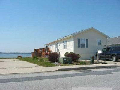 Photo for Bayfront House W/ Decks Dock  Boatslip 2 Pools + Tennis  Court