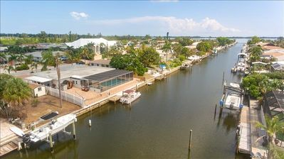 Photo for SAN REMO RETREAT 3 BEDROOM 3 BATH  PRIVATE CANAL POOL HOME- BRING YOUR BOAT (PET FRIENDLY)