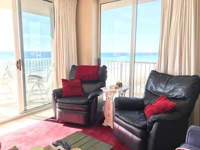 Living room sliding glass doors offer panoramic views of the gulf and bay!