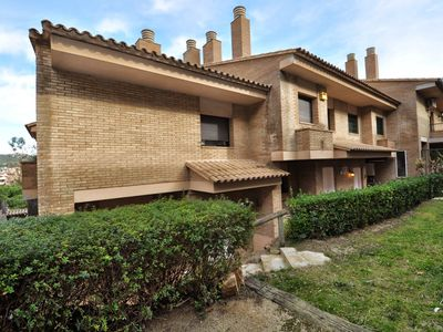 Photo for Townhouse with sea views, 2 min to the beach, with wifi, garden, parking, communal pool