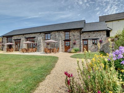 Photo for Rural barn in natural stone, offering stunning views and a Jacuzzi, located in Tiverton