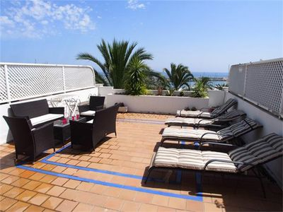 Photo for Sea front townhouse - community pool and air con, Estepona Marina near shops and restaurants