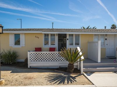 Photo for This Vintage Beach Cottage is located 1/2 block from the Harbor and Embarcadero.