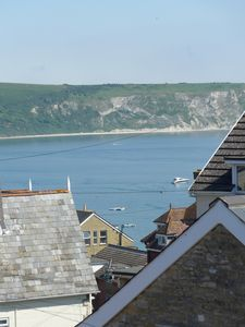 Photo for Light, Airy 1st Floor Apartment with delightful views over bay and Purbeck Hills