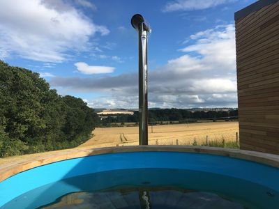 Photo for Orchard Hideaway with a wall of glass looking over the Tweed valley. Hot Tub.