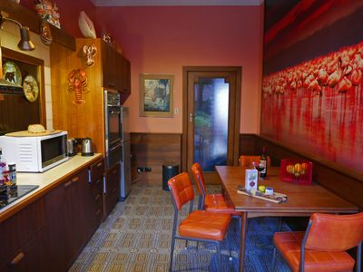 Flamingo kitchen has all amenities and utensils and a dining area.