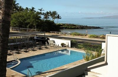 View of pool and ocean from rear lanai