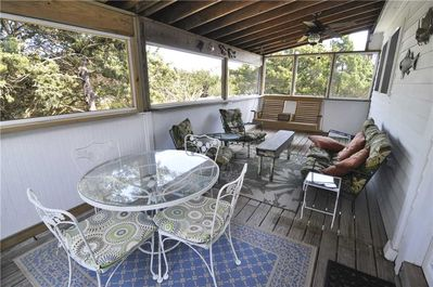 Rear Screened Porch with Seating and Dining Table