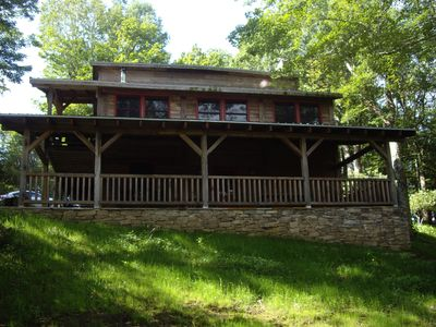 Porch view of house in summer.