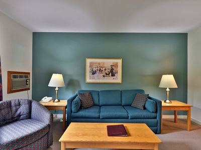 Photo for Deluxe one bedroom suite located on the first floor with outdoor heated pool