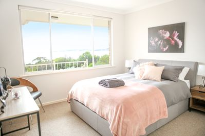 Relax in bed with views of the bay