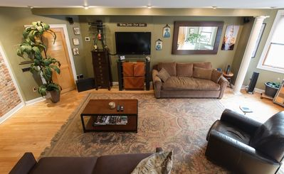 Features flat screen TV with cable and two large couches with pull out beds!