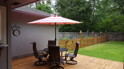 Patio table with umbrella and gas grill on the deck