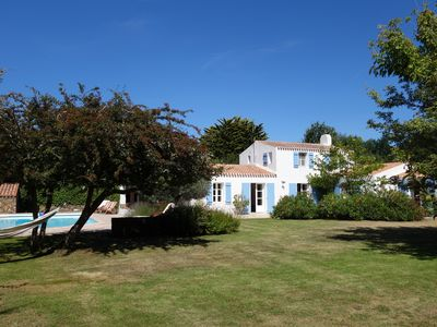 Photo for Large charming family home in secluded garden with heated pool.