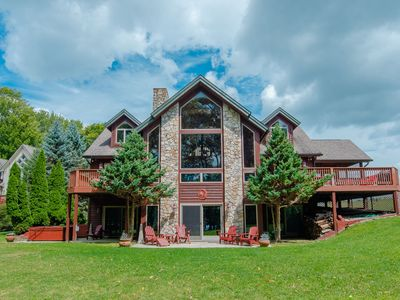 Lakefront home with dock slip, pool table, hot tub and community amenities!