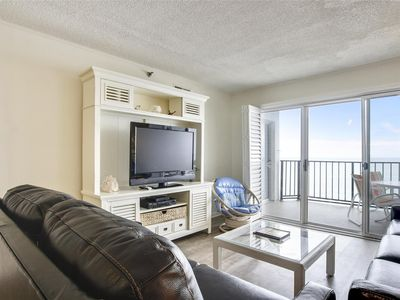 Photo for LINENS INCLUDED*! Direct Oceanfront 2 bedroom, 2 bath updated condo with an open den. Balcony access from living room and master bedroom