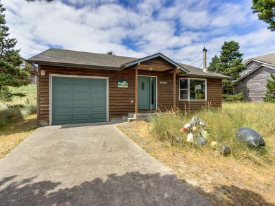 Photo for Charming home w/ modern comforts & two master suites - steps to beach!