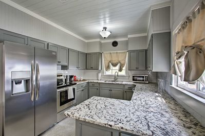 The kitchen features stainless steel appliances.