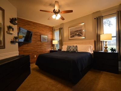 Photo for Modern decor, lake view, minutes from Disney with a heated pool