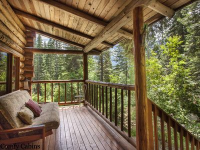 Photo for Genuine Log Cabin with private hot tub, near lots of hiking & WiFi!