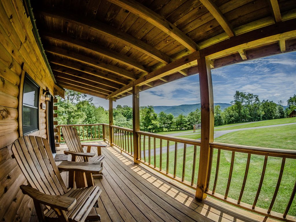 surrounded in at our wv with view log of exterior ground hot cabins covered luxury by s tub cabin harman bedroom snow tour