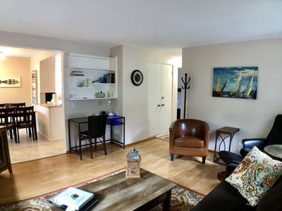 Roomy and cozy living room with desk and high def TV