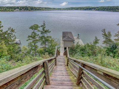 Photo for NEW LISTING! Lakefront home w/stunning views, deep water dock, firepit & canoe