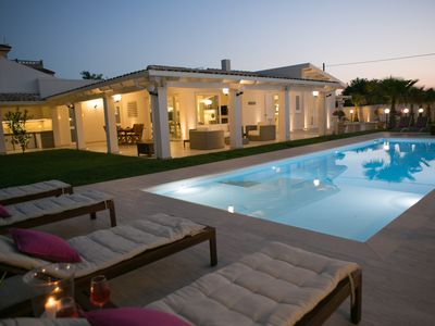 Photo for Fantastic villa with swimming pool just steps from the golden beach.