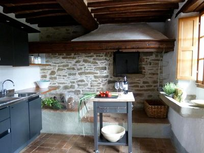 Kitchen with activ oven for pizza