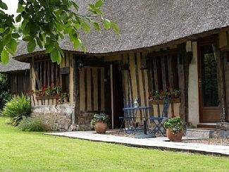 Photo for Charming Thatched Cottage with Enclosed Garden on the Normandy Coast