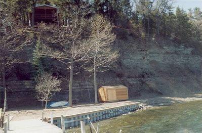 The beach and dock with cottage perched above