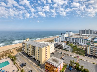 Photo for Oceanview condo with private balcony, shared pool access - walk to the beach!