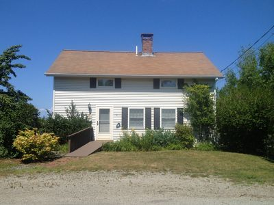 Photo for Oceanfront Cottage with views of a traditional Maine fishing harbor