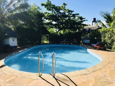 Photo for partially air conditioned cottage family friendly with fenced swimming pool