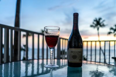 Enjoy a glass of wine on our balcony while watching the spectacular setting sun