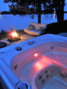 Relax in the hot tub while watching the lake from our deck!