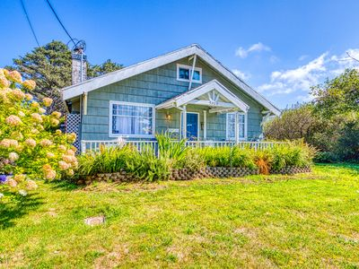 Photo for Dog-friendly, welcoming classic beach cottage with water views!