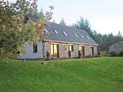 Photo for Well equipped home with loch, mountain and woodland views