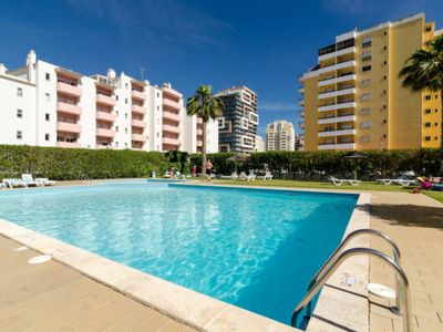 Photo for 1 room Duplex with WIFI and pool, only a 5 minute walk to the beach