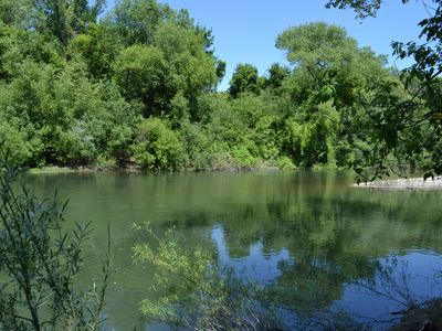 Photo for Riverfront Cottage with large yard. Beautiful setting - private river beach.