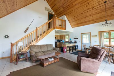 Open floor plan with living, dining, and kitchen.