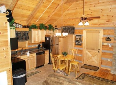 Fully stocked kitchen with log dining..
