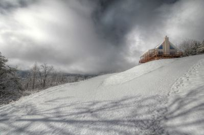 Snow in the mountains! Come sit a while in the hot tub while it snows.