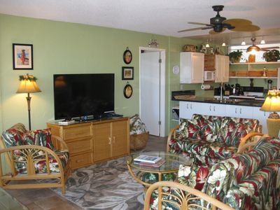 Open floor plan with new 55-inch Smart TV and newly upholstered furniture.