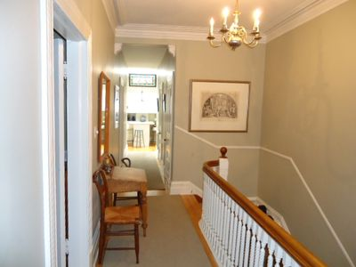 320 hallway with view to kitchen. Two baths & bedrooms 1 & 2  are off this hall