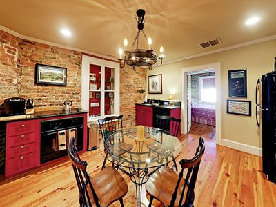 Dining Area - The open kitchen has a full suite of all-black appliances.